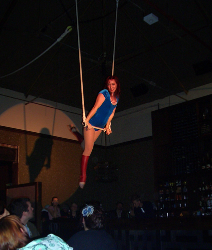 Ms. Rocket on the trapeze::